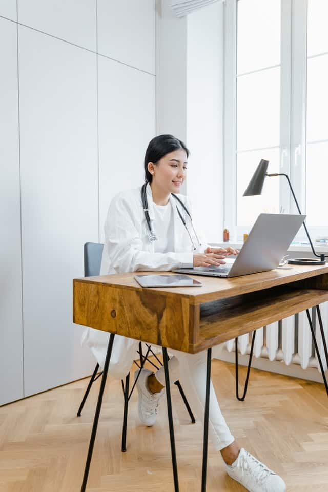 image of person at desk having telemecine appointment